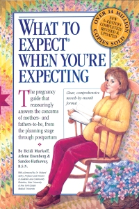 "Dated cover of ""What to Expect When You're Expecting"": Illustrating of a woman on rocker, reading a blank-paged book, wearing yellow sweater set and bright burgundy pants."